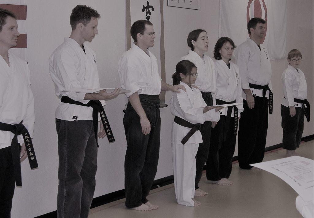 karate girl accepting certificate