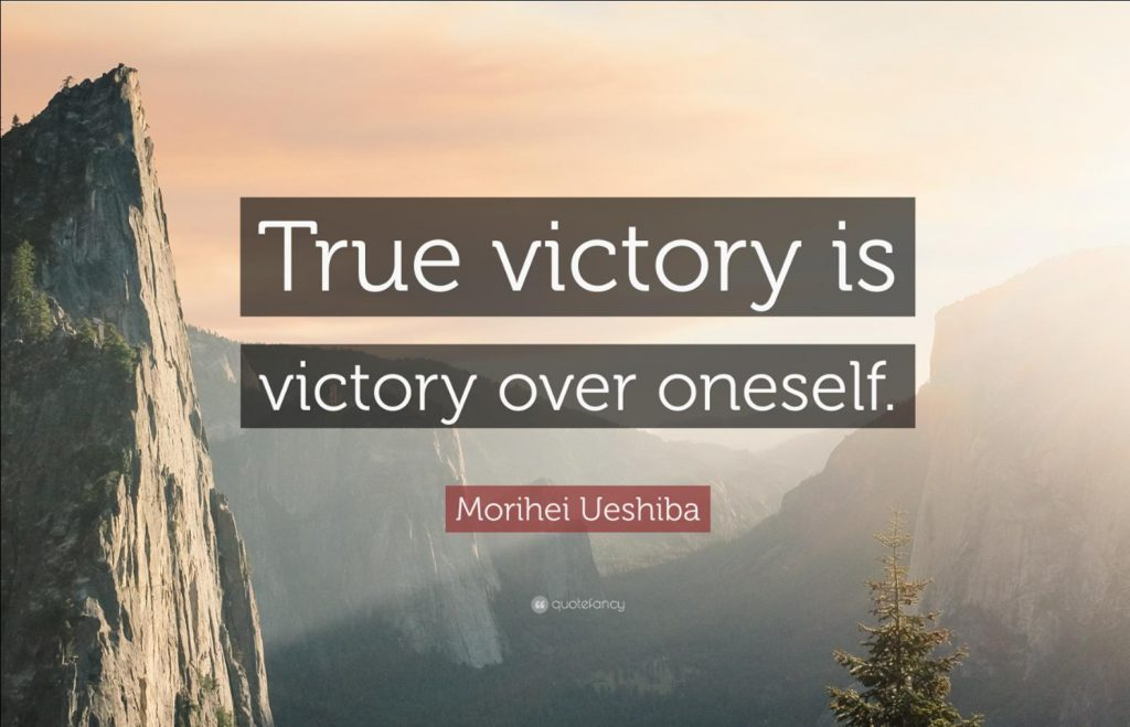 """Poster in Makoto's room shows a landscape scene quoting Morihei Ueshiba, """"True victory is victory over oneself."""""""