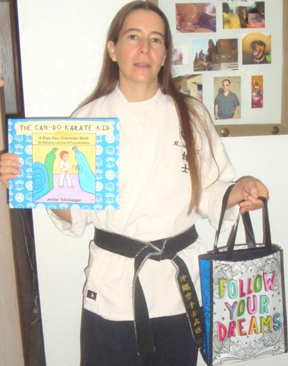 """the author with her character building book in one hand and the """"Follow Your Dreams"""" bag in the other hand"""